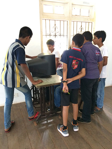 children interact factory
