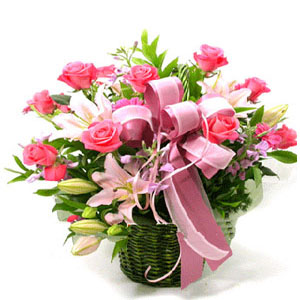 Pink roses and lilies in basket