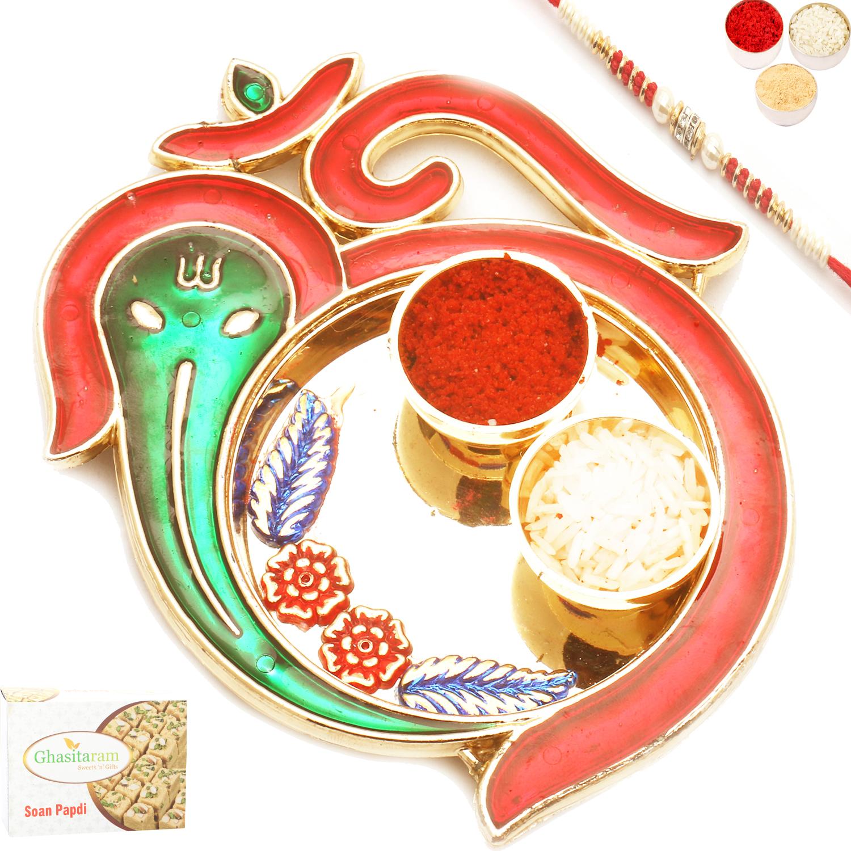 Om Ganeshaya Pooj Thali with Red Pear Rakhi n 400Gm Soan Papdi