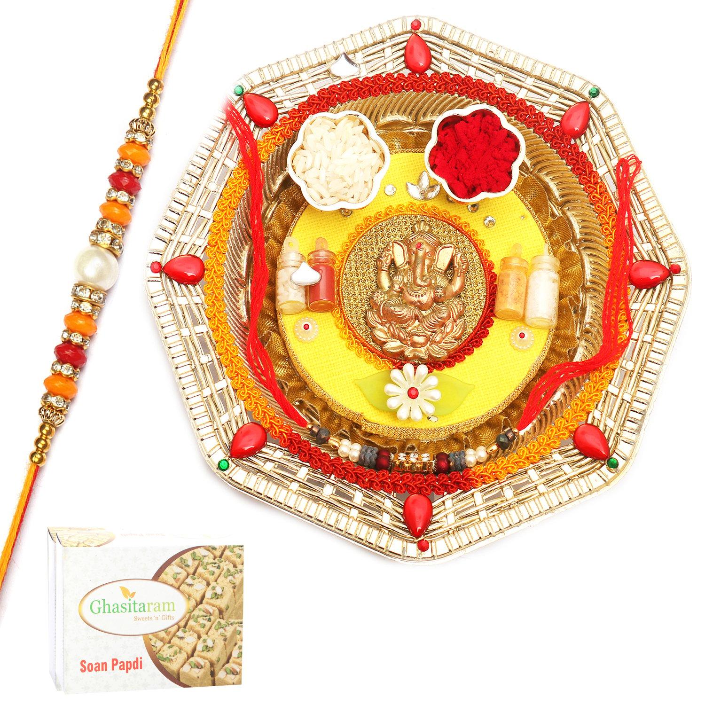 Round Ganesh Pooja Thali with Pearl Diamond Rakhi n 200Gm Soan Papdi