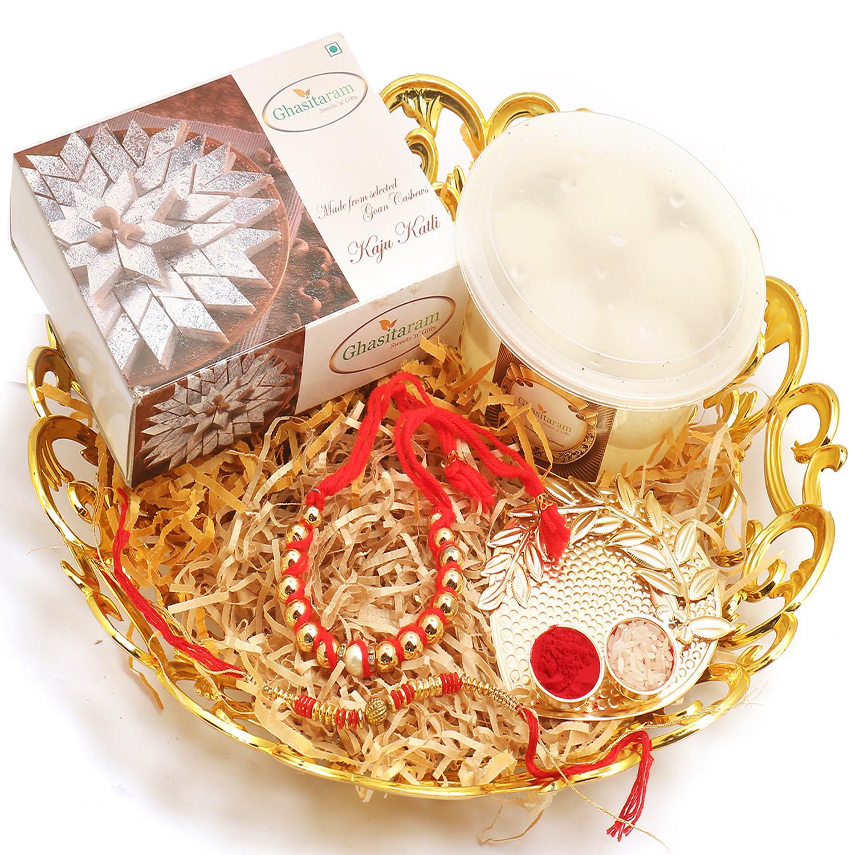 Gold Carved Basket of Kaju Katli, Rasgulla, Pooja Thali and Reflection Of Truth Bhaiya Bhabhi Rakhi