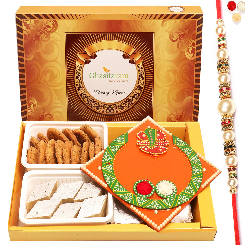 Big Box of Kaju Katli, Methi Mathi and Orange Ganesha Pooja Thali with Pearl Rakhi
