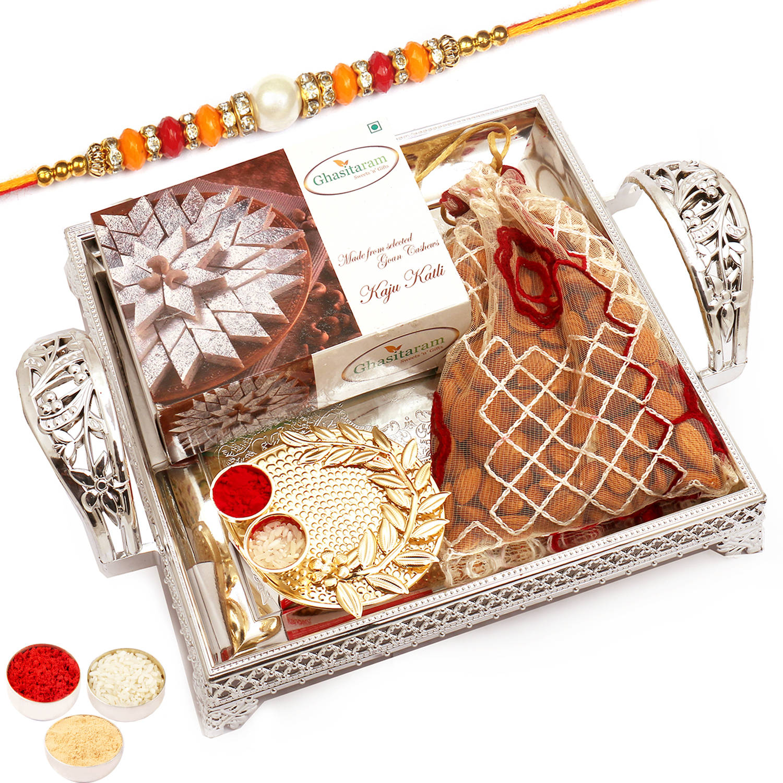 Silver Tray with Kaju Katli, Almonds and Mini Pooja Thali with Pearl Diamond Rakhi